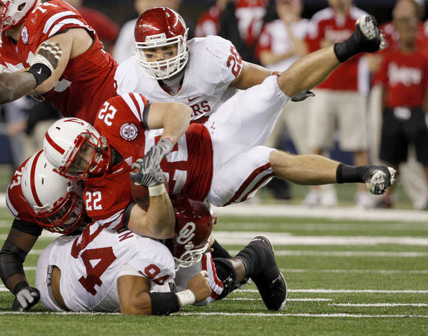 OU's Pryce Macon brings down Nebraska's Rex Burkhead as Travis Lewis watches during the Big 12 football championship game between the University of Oklahoma Sooners (OU) and the University of Nebraska Cornhuskers (NU) at Cowboys Stadium on Saturday, Dec. 4, 2010, in Arlington, Texas.  Photo by Bryan Terry, The Oklahoman