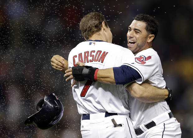 Cleveland Indians' Mike Aviles, right, hugs Matt Carson (7) after Carson's bases-loaded single in the 11th inning gave the Indians a 2-1 win over the Houston Astros in a baseball game Thursday, Sept. 19, 2013, in Cleveland. (AP Photo/Mark Duncan)