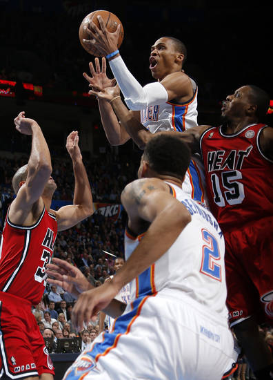 Oklahoma City's Russell Westbrook (0) goes to the bas let between Miami's Shane Battier (31) and Miami's Mario Chalmers (15) during an NBA basketball game between the Oklahoma City Thunder and the Miami Heat at Chesapeake Energy Arena in Oklahoma City, Thursday, Feb. 15, 2013. Photo by Bryan Terry, The Oklahoman
