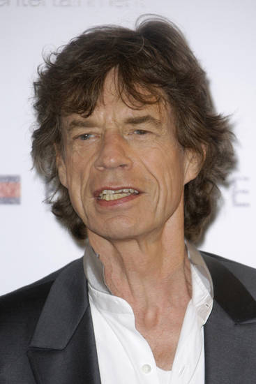 "FILE - In this May 19, 2010 file photo, musician Mick Jagger poses during a photo call for the film ""Stones in Exile"", at the 63rd international film festival, in Cannes, southern France. (AP Photo/Joel Ryan, file) ORG XMIT: NYET349"