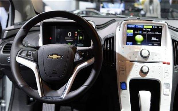 The interior of the Chevy Volt, 2011 Green Car of the Year, presented by Green Car Journal, is seen at the LA Auto Show Thursday, Nov. 18, 2010. (AP Photo/Reed Saxon)