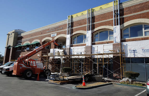 Brookhaven Professional Center is getting a face-lift. Workers are putting new fronts on the center, which is part of the Brookhaven Square retail district on 36th Avenue NW at Robinson Street. The face-lift will brighten the exterior and improve the building&acirc;s structure, officials said. PHOTO BY STEVE SISNEY, THE OKLAHOMAN
