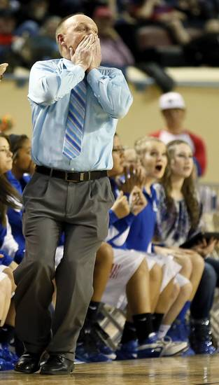 Hammon coach Lance Carpenter reacts to a call during a Class B Girls semifinal game of the state high school basketball tournament between Hammon and Lomega at Jim Norick Arena, The Big House, on State Fair Park in Oklahoma City, Friday, March 1, 2013. Photo by Nate Billings, The Oklahoman