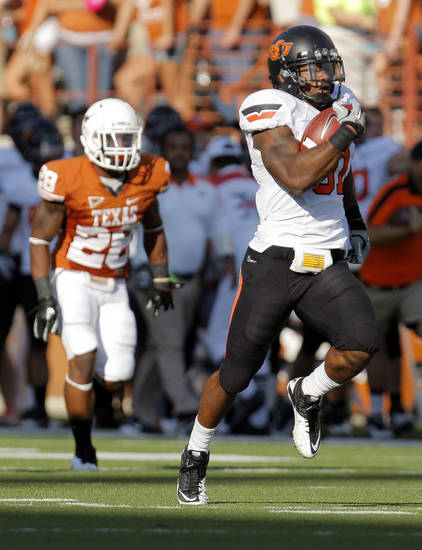 Oklahoma State's Jeremy Smith (31) breaks away from Texas' Quandre Diggs (28) on a long touchdown run in the third quarter during a college football game between the Oklahoma State University Cowboys (OSU) and the University of Texas Longhorns (UT) at Darrell K Royal-Texas Memorial Stadium in Austin, Texas, Saturday, Oct. 15, 2011. OSU won, 38-26. Photo by Nate Billings, The Oklahoman