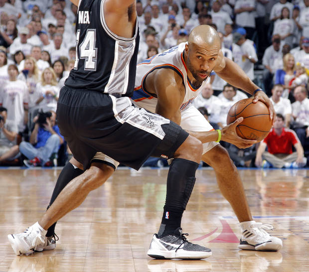 Oklahoma City's Derek Fisher (37) looks to drive past San Antonio's Gary Neal (14) during Game 6 of the Western Conference Finals between the Oklahoma City Thunder and the San Antonio Spurs in the NBA playoffs at the Chesapeake Energy Arena in Oklahoma City, Wednesday, June 6, 2012. Photo by Chris Landsberger, The Oklahoman