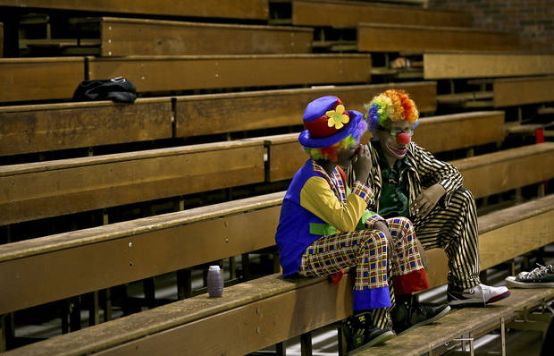 Circus clowns Henry Peoples and Shabarekh Smith wait to do their part at the rehearsal.