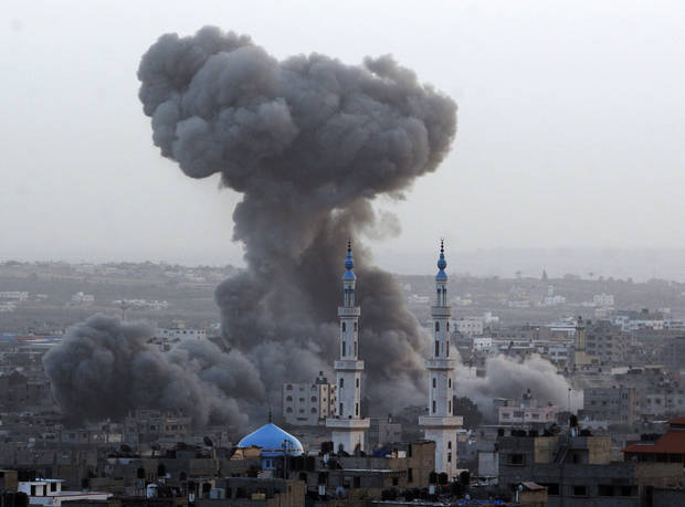   Smoke rises after an Israeli forces strike in Gaza City, Saturday, Nov. 17, 2012. Israel bombarded the Hamas-ruled Gaza Strip with nearly 200 airstrikes early Saturday, the military said, widening a blistering assault on Gaza rocket operations by militants to include the prime minister&#039;s headquarters, a police compound and a vast network of smuggling tunnels. (AP Photo/Hatem Moussa)  