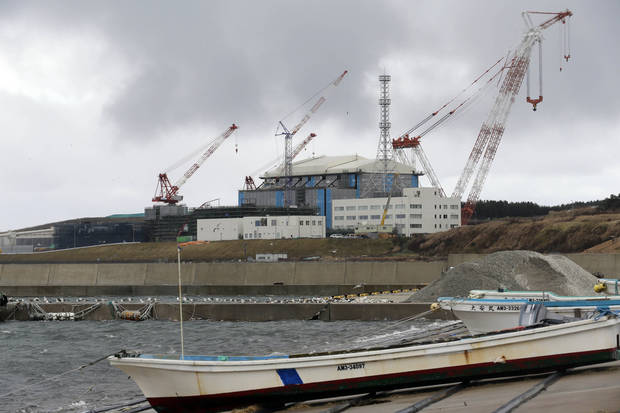 In this Nov. 9, 2012 photo, cranes stand around the Oma nuclear power plant in Oma in Aomori, northern Japan. In nearby Oma, construction is set to resume on an advanced reactor that is not a fast-breeder but can use more plutonium than conventional reactors. Its construction, begun in 2008 for planned operation in 2014, has been suspended since the March 2011 Fukushima nuclear meltdowns, and could face further delays as Japan's new nuclear watchdog prepares new safety guidelines. (AP Photo/Koji Sasahara)