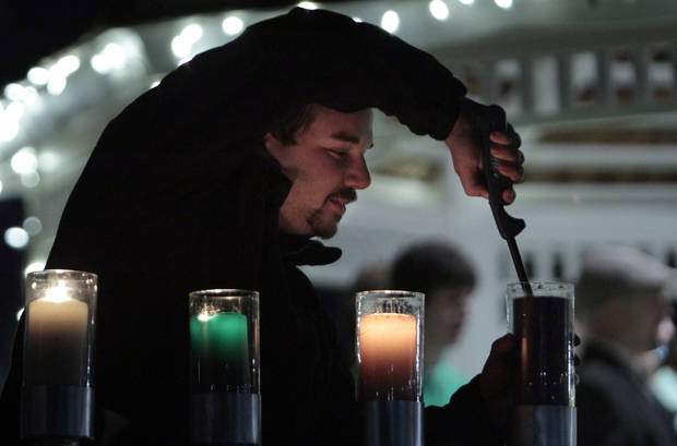 Matthew Lorch, senior from West Hills, Calif., lights menorah candles at the University of Oklahoma's (OU) Holiday Lighting Celebration on Wednesday, Nov. 28, 2012, in Norman, Okla.  