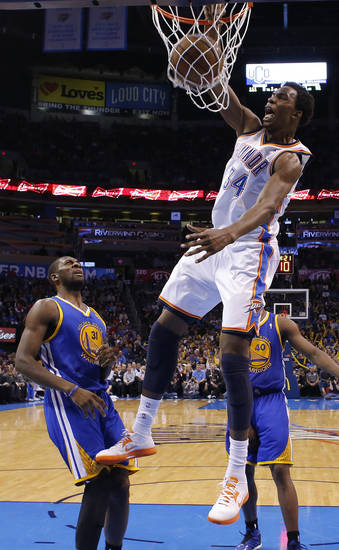 Oklahoma City's Hasheem Thabeet (34) dunks the ball beside Golden State's Festus Ezeli (31) during an NBA basketball game between the Oklahoma City Thunder and the Golden State Warriors at Chesapeake Energy Arena in Oklahoma City, Wednesday, Feb. 6, 2013. Photo by Bryan Terry, The Oklahoman