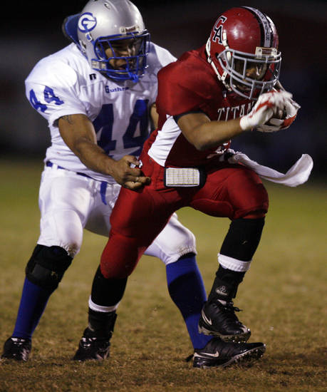 Carl Albert's Sterling Wright (7) breaks a tackle attempt by Guthrie's Josh King (44) in first half action in high school football at Jim Harris Stadium  in Midwest City, Oklahoma on Thursday October 16, 2008.  
