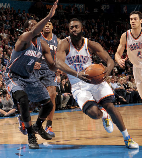Oklahoma City Thunder's James Harden (13) drives to the basket past Charlotte Bobcats' D.J. White (8) during the NBA basketball game between the Oklahoma City Thunder and the Charlotte Bobcats at Chesapeake Energy Arena in Oklahoma City, Saturday, March 10, 2012. Photo by Steve Sisney, The Oklahoman