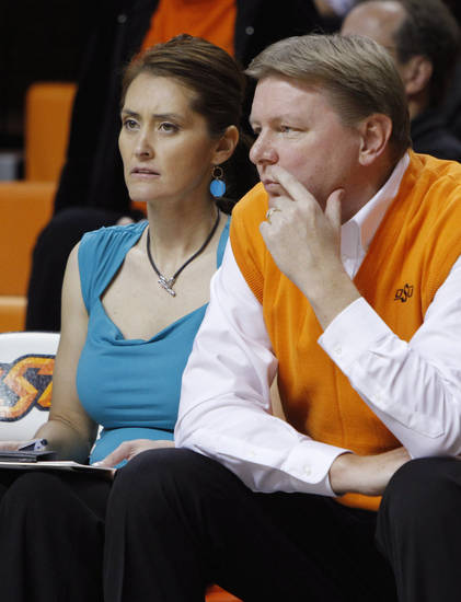 This Nov. 9, 2011 photo shows Oklahoman State women's basketball coach Kurt Budke and assistant coach Miranda Serna during an an exhibition women's NCAA college basketball game against Fort Hays State, in Stillwater, Okla.  Budke and Serna were killed when the single-engine plane they were riding in during a recruiting trip crashed near a wildlife management area in central Arkansas. The university said the pair died in the crash Thursday night, Nov. 17, 2011. PHOTO BY BRYAN TERRY, THE OKLAHOMAN