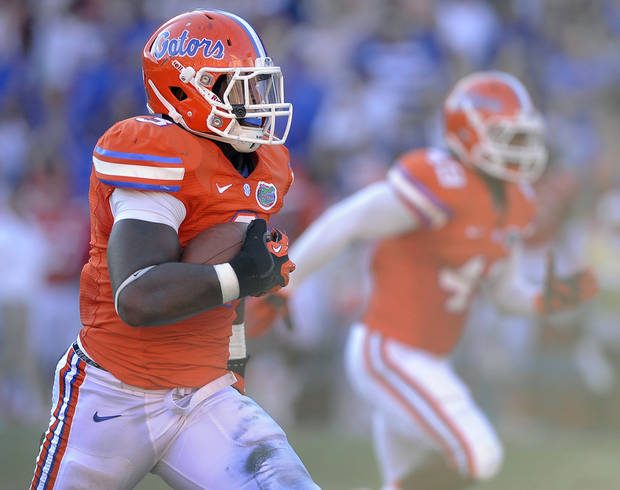 Florida linebacker Jelani Jenkins (3) runs for a touchdown after picking up a blocked punt during the second half of an NCAA college football game against Louisiana-Lafayette in Gainesville, Fla., Saturday, Nov. 10, 2012. Florida won 27-20. (AP Photo/Phil Sandlin)