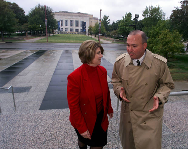 Ashley Perkins and Mark Funke are shown in this November, 2002 photo discussing plans to establish the first Downtown in December ice skating rink at the Civic Center park, shown in background. <strong>STEVE SISNEY</strong>