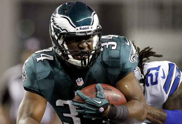 Philadelphia Eagles running back Bryce Brown (34) is pursued by Dallas Cowboys cornerback Mike Jenkins (21) during the first half of an NFL football game, Sunday, Dec. 2, 2012, in Arlington, Texas. (AP Photo/Tony Gutierrez)
