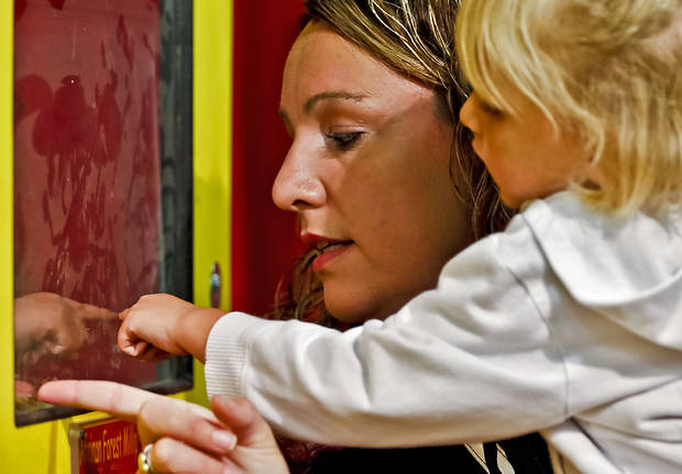 Tammy Dixon and her daughter Dani get a closer look at bugs in AGtropolis at the Oklahoma State Fair at State Fair Park on Friday, Sept. 14, 2012, in Oklahoma City, Oklahoma.  Photo by Chris Landsberger, The Oklahoman