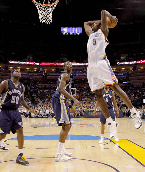 Oklahoma City's Serge Ibaka dunks the ball over Zach Randolph, left, Hasheem Thabeet, and Sam Young of Memphis during the NBA basketball game between the Oklahoma City Thunder and the Memphis Grizzlies at the Ford Center in Oklahoma City on Wednesday, April 14, 2010. 