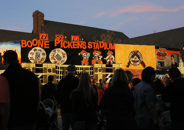 People stop in front of the Pi Kappa Alpha/Phi Mu house decoration during Walkaround at Oklahoma State University's homecoming in Stillwater, Okla., Friday, Oct. 19, 2012. Photo by Nate Billings, The Oklahoman