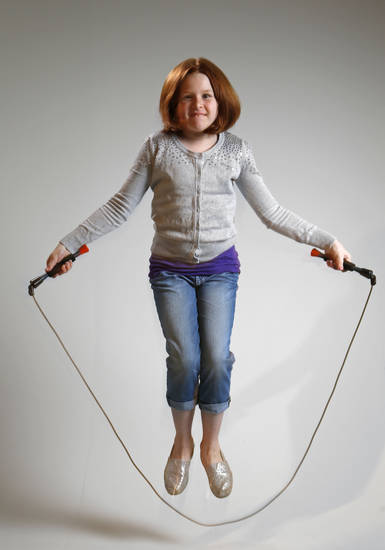 Ella Turner, 8, poses for a picture as she jumps rope. She is an American Heart Association ambassador. Ella is raising money for the annual Jump Rope for Heart in honor of her 2-year-old sister, Colby, who died from a heart disease.  PHOTOS BY BRYAN TERRY, THE OKLAHOMAN