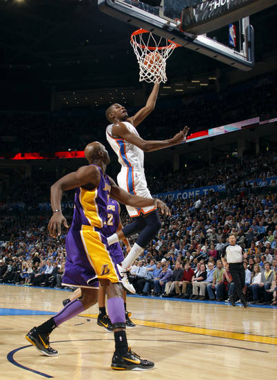 Oklahoma City's Kevin Durant (35) shoots as Lakers' Lamar Odom (7) looks on during the NBA basketball game between the Oklahoma City Thunder and the Los Angeles Lakers, Sunday, Feb. 27, 2011, at the Oklahoma City Arena.Photo by Sarah Phipps, The Oklahoman