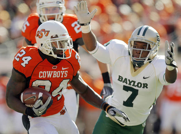 OSU's Kendall Hunter (24) tries to get past Antonio Johnson (7) of Baylor in the first quarter during the college football game between the Oklahoma State University Cowboys (OSU) and the Baylor University Bears at Boone Pickens Stadium in Stillwater, Okla., Saturday, Nov. 6, 2010. Photo by Nate Billings, The Oklahoman