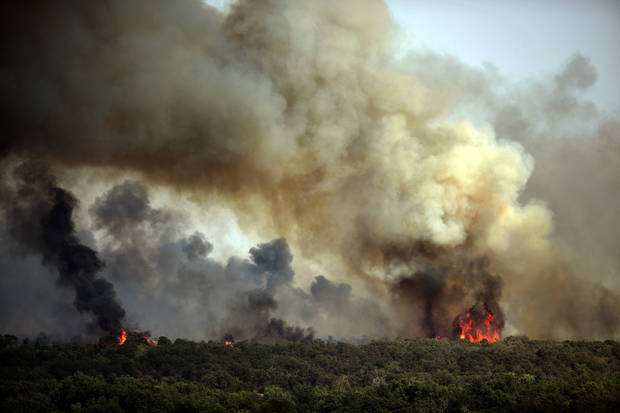 A wildfire burns in Luther, Okla.,  Friday, Aug. 3, 2012. Photo by Sarah Phipps, The Oklahoman