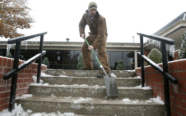 WINTER / COLD / WEATHER / ICE STORM: Oklahoma Christian University intramural director Rick Judd shovels ice from stairs on Monday December 10, 2007. Most of the campus was left without power after ice storms moved through the metro area. BY SARAH PHIPPS/THE OKLAHOMAN   ORG XMIT: KOD