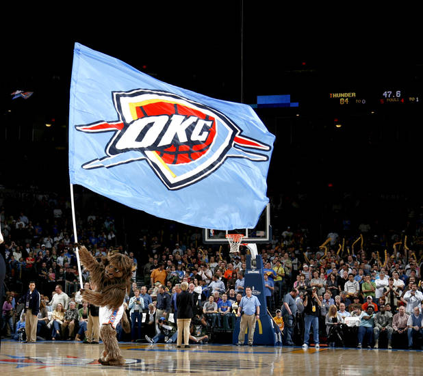 Oklahoma City mascot Rumble the Bison performs for the crowd during the NBA basketball game between the Oklahoma City Thunder and the Washington Wizards at the Ford Center in Oklahoma City, Wed., March 4, 2009. PHOTO BY BRYAN TERRY, THE OKLAHOMAN
