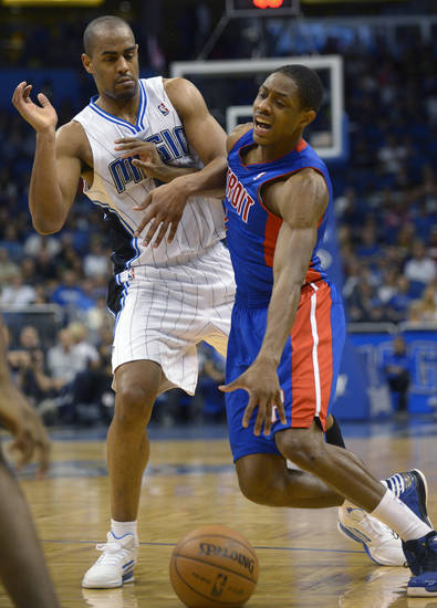 Detroit Pistons guard Brandon Knight, right, is fouled by Orlando Magic guard Arron Afflalo while driving to the basket during the first half of an NBA basketball game in Orlando, Fla., Sunday, Jan. 27, 2013.(AP Photo/Phelan M. Ebenhack)