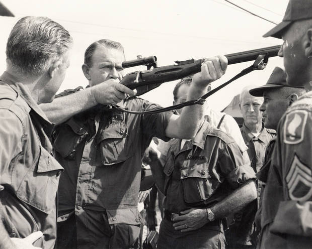 On a trip to Vietnam, Gov. Henry Bellmon sights through a Russian sniper rifle captured by U.S. troops during an operation in 1965. OKLAHOMAN ARCHIVE PHOTO