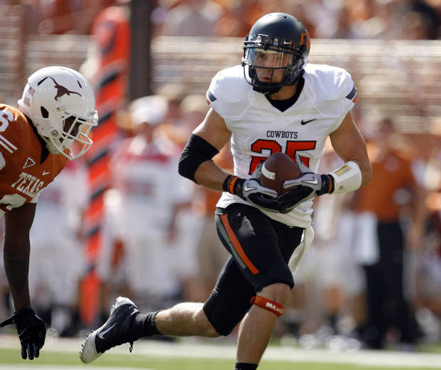 Oklahoma State's Josh Cooper (25) gets by Texas' Christian Scott (6) during first half of a college football game between the Oklahoma State University Cowboys (OSU) and the University of Texas Longhorns (UT) at Darrell K Royal-Texas Memorial Stadium in Austin, Texas, Saturday, Oct. 15, 2011. Photo by Sarah Phipps, The Oklahoman