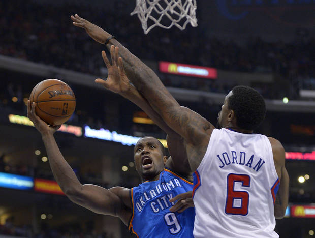 Oklahoma City Thunder forward Serge Ibaka, left, of Congo, puts up a shot as Los Angeles Clippers center DeAndre Jordan defends during the second half of their NBA basketball game, Tuesday, Jan. 22, 2013, in Los Angeles. The Thunder won 109-97.  (AP Photo/Mark J. Terrill)  ORG XMIT: LAS112