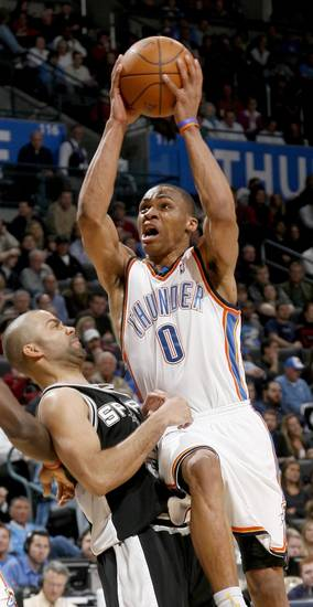 Oklahoma City's Russell Westbrook shoots the ball over San Antonio's Tony Parker during the NBA basketball game between the Oklahoma City Thunder and the San Antonio Spurs at the Ford Center in Oklahoma City, Wednesday, January 13, 2010. Photo by Bryan Terry, The Oklahoman