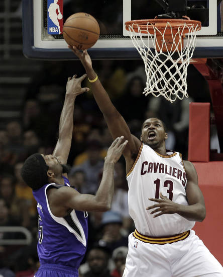 Cleveland Cavaliers' Tristan Thompson, right, shoots over Sacramento Kings' John Salmons during the first quarter of an NBA basketball game on Wednesday, Jan. 2, 2013, in Cleveland. (AP Photo/Tony Dejak)