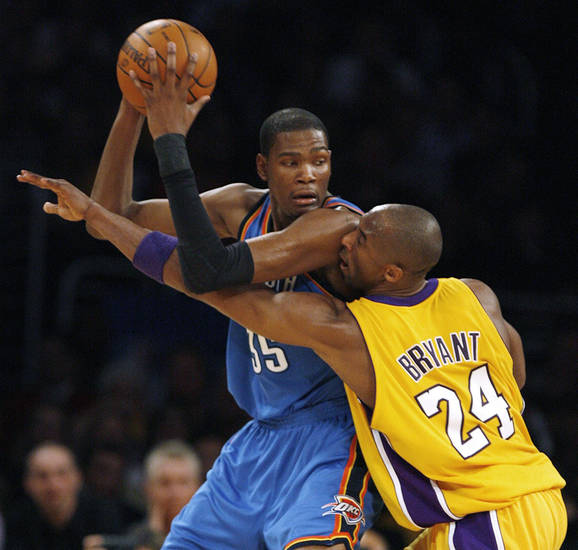 Oklahoma City Thunder forward Kevin Durant keeps the ball away from Los Angeles Lakers guard Kobe Bryant (24) in the first half during Game 2 of a first-round NBA basketball playoff series, Tuesday, April 20, 2010, in Los Angeles. (AP Photo/Alex Gallardo) ORG XMIT: LAS103
