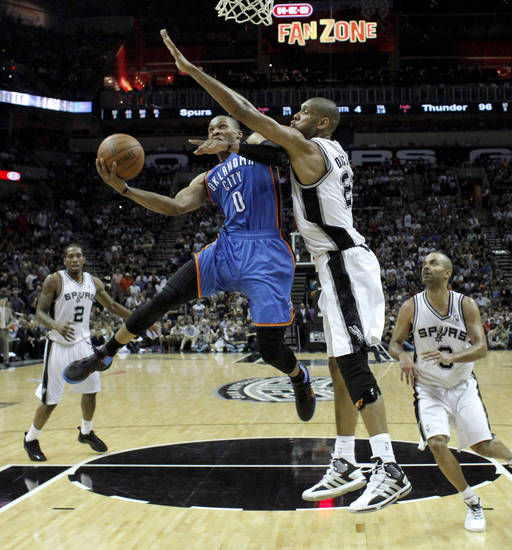 Oklahoma City's Russell Westbrook (0) goes past San Antonio's Tim Duncan (21) during Game 2 of the Western Conference Finals between the Oklahoma City Thunder and the San Antonio Spurs in the NBA playoffs at the AT&T Center in San Antonio, Texas, Tuesday, May 29, 2012. Oklahoma City lost 120-111. Photo by Bryan Terry, The Oklahoman