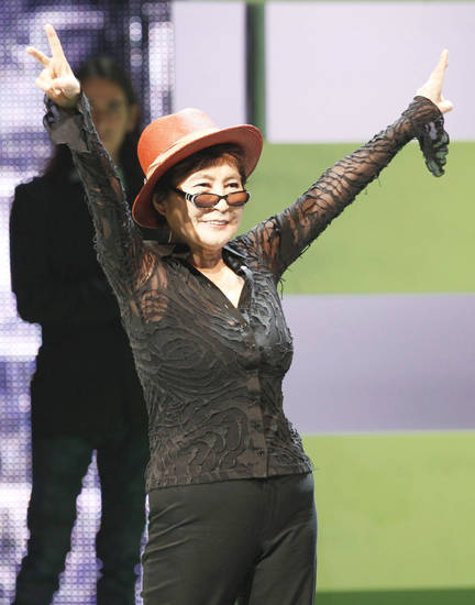 "Yoko Ono acknowledges the crowd at the launch of ""The  Beatles: Rock Band"" Xbox game Monday. AP PHOTO"