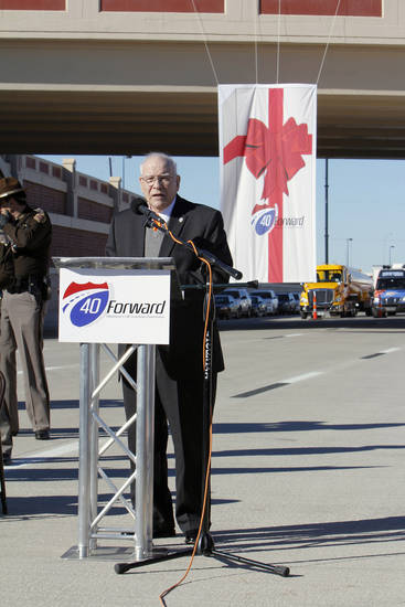 Gary Ridley, Oklahoma Secretary of Transportation, speaking during grand opening ceremonies for the east bound lanes of the I-40 Crosstown in Oklahoma City Thursday, Jan. 5, 2012. In the background is the Western Ave. bridge. Photo by Paul B. Southerland, The Oklahoman ORG XMIT: KOD