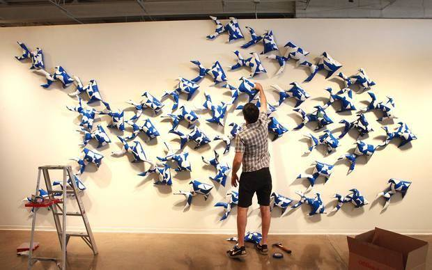 "Dallas-based artist Jason Willaford installs vinyl fish he crafted from a reclaimed billboard into an installation titled ""In Business for Small Business"" at Oklahoma Contemporary Arts Center. The installation is part of his exhibit ""Vinyl Exposed"" at the gallery. Photos by David McDaniel, The Oklahoman"