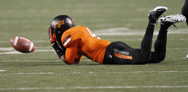 Oklahoma State's Justin Gilbert (4) reacts after missing an interception during the Bedlam college football game between the Oklahoma State University Cowboys (OSU) and the University of Oklahoma Sooners (OU) at Boone Pickens Stadium in Stillwater, Okla., Saturday, Dec. 3, 2011. Photo by Chris Landsberger, The Oklahoman
