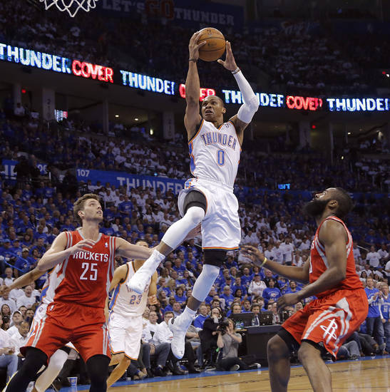 Oklahoma City's Russell Westbrook (0) drives between Houston's Chandler Parsons (25) and James Harden (13) during Game 2 in the first round of the NBA playoffs between the Oklahoma City Thunder and the Houston Rockets at Chesapeake Energy Arena in Oklahoma City, Wednesday, April 24, 2013. Photo by Chris Landsberger, The Oklahoman