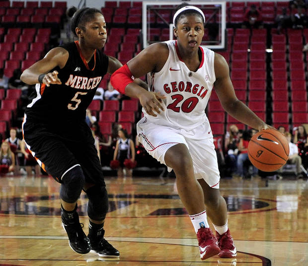 Mercer forward Sharmesia Smith (5) pressures Georgia's Shacobia Barbee (20) during the second half of an NCAA college basketball game, Tuesday, Dec. 4, 2012, in Athens, Ga. Georgia won 80-38. (AP Photo/Richard Hamm)