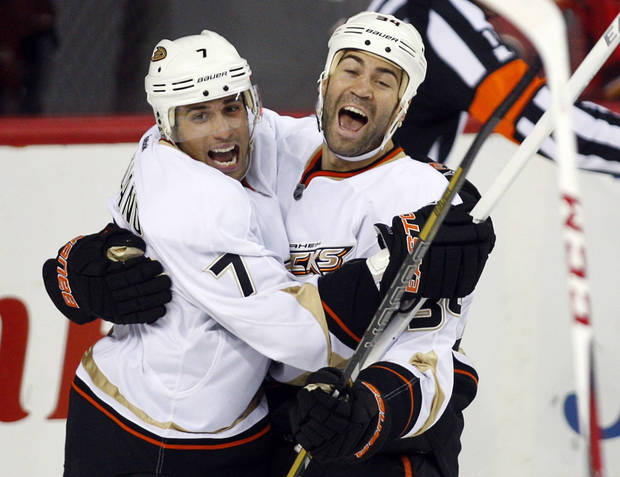 Anaheim Ducks&#039; Daniel Winnik, right, celebrates his goal against the Calgary Flames with Andrew Cogliano during the third period of their NHL hockey game, Monday, Jan. 21, 2013, in Calgary, Alberta. The Ducks won 5-4. (AP Photo/The Canadian Press, Jeff McIntosh)