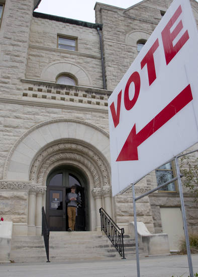 A sign directs early voters at the Douglas County court house in Lawrence, Kan., Monday, Nov. 5, 2012. About 30 million people have already voted in 34 states and the District of Columbia, either by mail or in person. (AP Photo/Orlin Wagner)