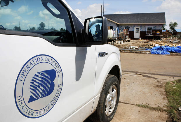 A vehicle from Operation Blessing in Virginia is parked near the site of a tornado-damaged home at 113 SW 8 in Moore, which is being rebuilt by volunteers. PHOTO BY JIM BECKEL, THE OKLAHOMAN <strong>Jim Beckel</strong>