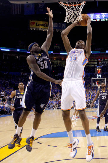 Oklahoma City's Kevin Durant (35) goes to the as Zach Randolph (50) of Memphis defends during game 7 of the NBA basketball Western Conference semifinals between the Memphis Grizzlies and the Oklahoma City Thunder at the OKC Arena in Oklahoma City, Sunday, May 15, 2011. Photo by Sarah Phipps, The Oklahoman