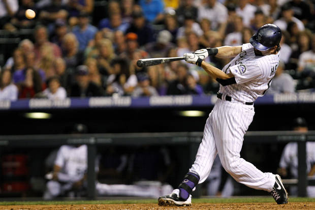 Colorado Rockies' Todd Helton hits a three-run home run on a pitch by Cincinnati Reds' Logan Ondrusek during the seventh inning of a baseball game, Friday, Aug. 30, 2013, in Denver. (AP Photo/Barry Gutierrez)