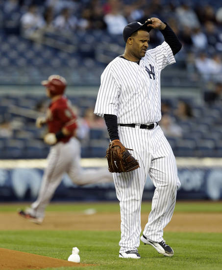 New York Yankees starting pitcher CC Sabathia reacts after allowing a first-inning, two-run home run to Arizona Diamondbacks' Paul Goldschmidt in a baseball game at Yankee Stadium in New York, Wednesday, April 17, 2013. (AP Photo/Kathy Willens)