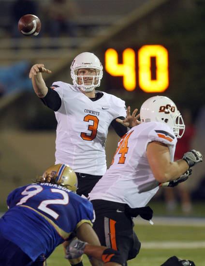 Oklahoma State's Brandon Weeden (3)throws a pass during the third quarter of the college football game between the Oklahoma State University Cowboys and the University of Tulsa Golden Hurricane at H.A. Chapman Stadium in Tulsa, Okla., Sunday, Sept. 18, 2011. Photo by Sarah Phipps, The Oklahoman